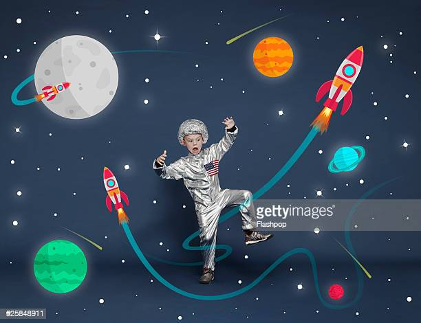 boy dressed as an astronaut. cartoon space scene - animation stock pictures, royalty-free photos & images