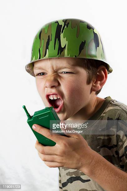 boy dressed as army soldier - army soldier toy stock pictures, royalty-free photos & images