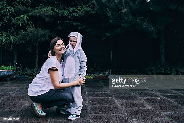 Boy dressed as bunny with mother