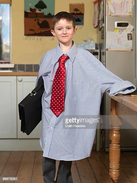 Boy dressed as business man
