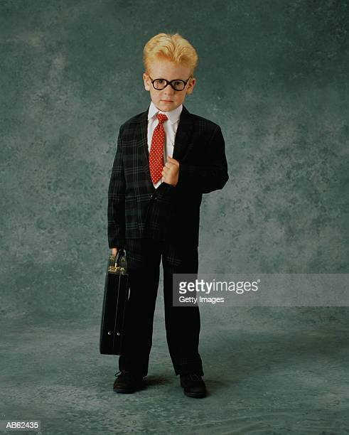 boy (3-5) dressed as business man with briefcase, portrait - child prodigy stock pictures, royalty-free photos & images
