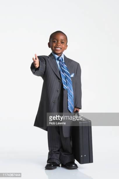 boy dressed as businessman - surdimensionné photos et images de collection