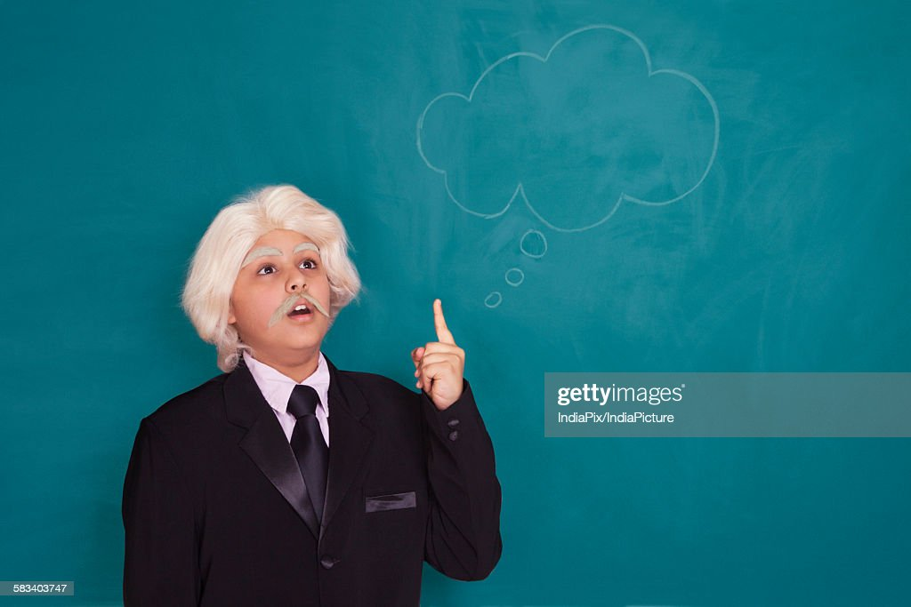 Boy dressed as Einstein thinking : Stock Photo