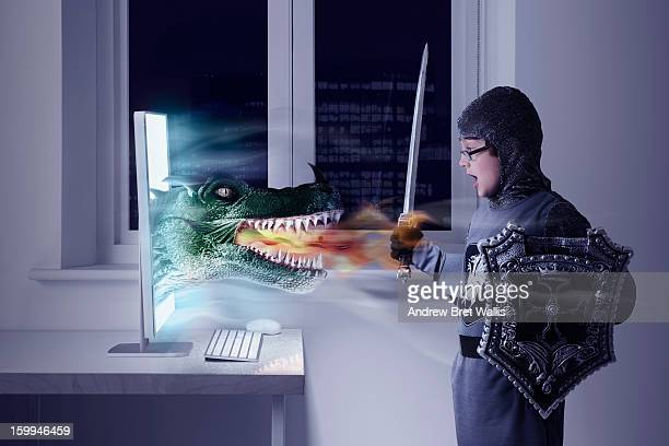 Boy dressed as knight confronts a computer dragon