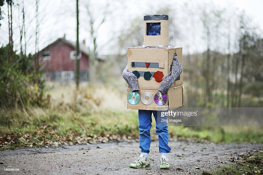 Boy dressed as robot outdoors : Stock Photo