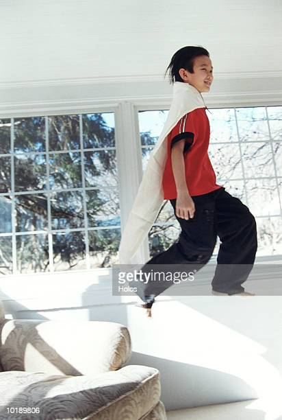 boy (8-10 years) dressed as superhero playing indoors - 10 11 years stock pictures, royalty-free photos & images