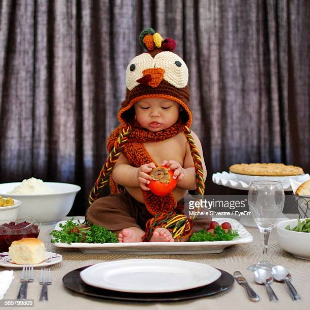 boy dressed as turkey on plate - funny turkey images stock photos and pictures