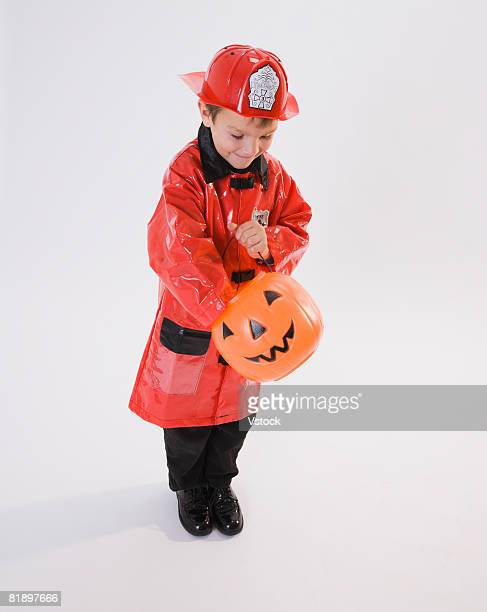 Boy dressed in fireman Halloween costume