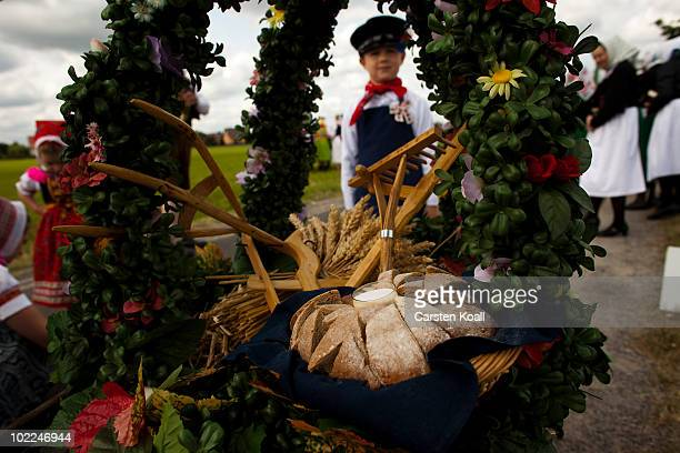 A boy dressed in traditional sorbian clothes carries the traditional bread and salt at the Sorbian procession on the occasion of the international...