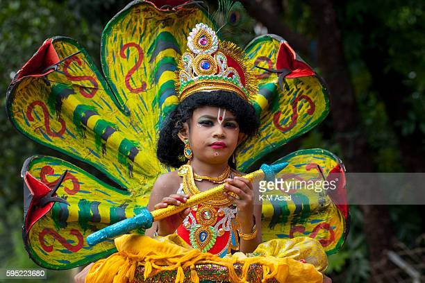 A boy dressed like Lord Sri Krishna as he take part in the celebration of the religious festival Janmashtami marking the birth anniversary of Lord...