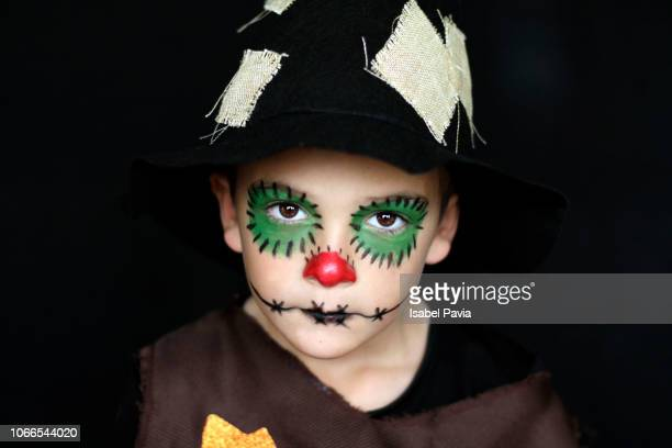 boy dressed up as a scarecrow - scarecrow faces stock photos and pictures