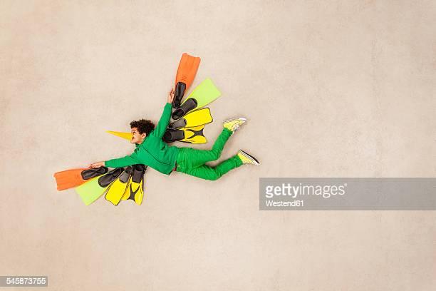 Boy dressed up as flying bird