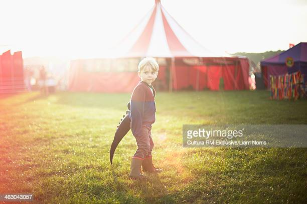 Boy dressed up at funfair