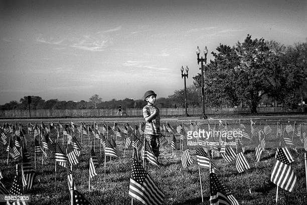 A boy dressed up in a military outfit says the last goodbyes to the fallen soldiers of the war in Iraq at a memorial in Washington DC Many US...
