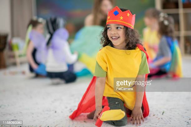boy dressed up in kings costume plays in a classroom - acting stock pictures, royalty-free photos & images