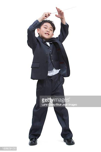 Boy dressing up like a conductor