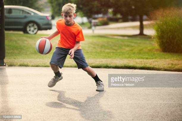 boy dribbling basketball - drive ball sports stock pictures, royalty-free photos & images