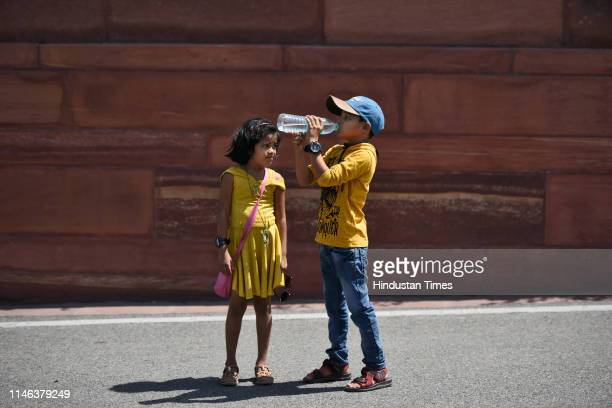 A boy drink water to get relief from the scorching heat on a hot day at Raisina Hills on May 26 2019 in New Delhi India During the last 24 hours the...