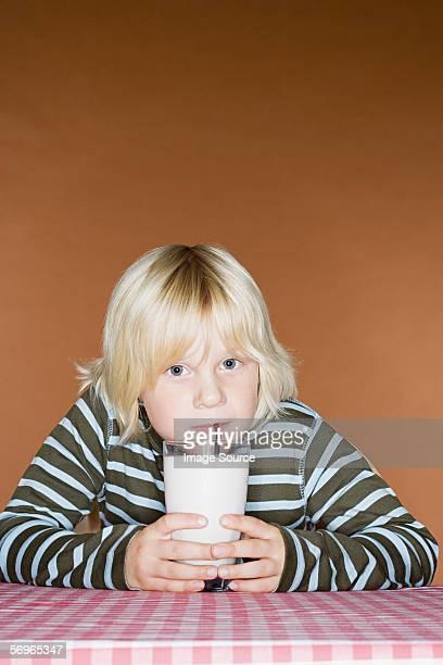 Boy drinking a milkshake