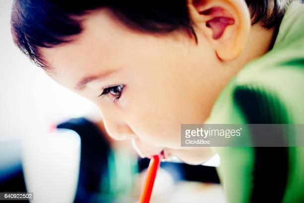 Boy drinking a milkshake through a straw