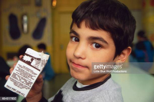 boy drinking chocolate milk - milk carton stock photos and pictures