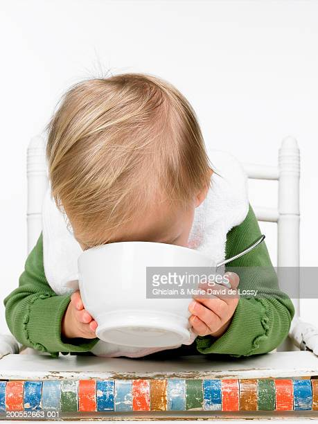 Boy (21-24 months) drinking from bowl, close-up