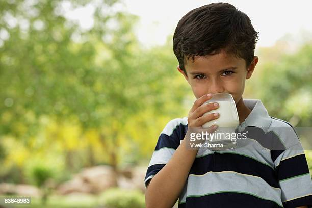 boy drinking glass of milk