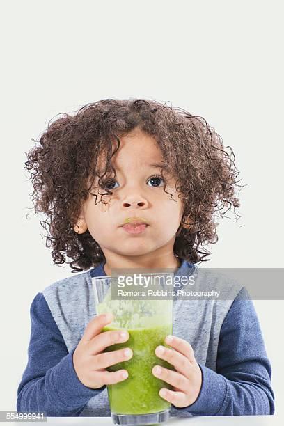 Boy drinking green smoothie