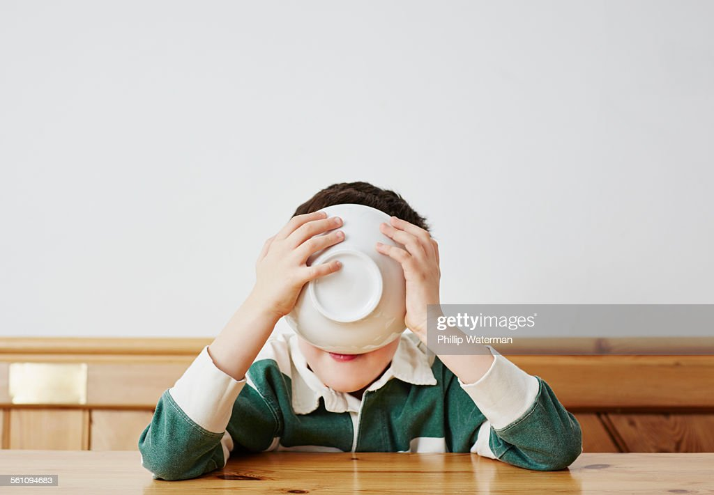 Boy drinking milk from bowl : ストックフォト