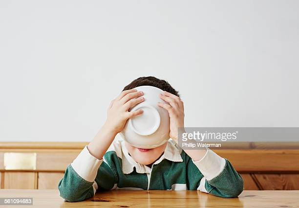 Boy drinking milk from bowl