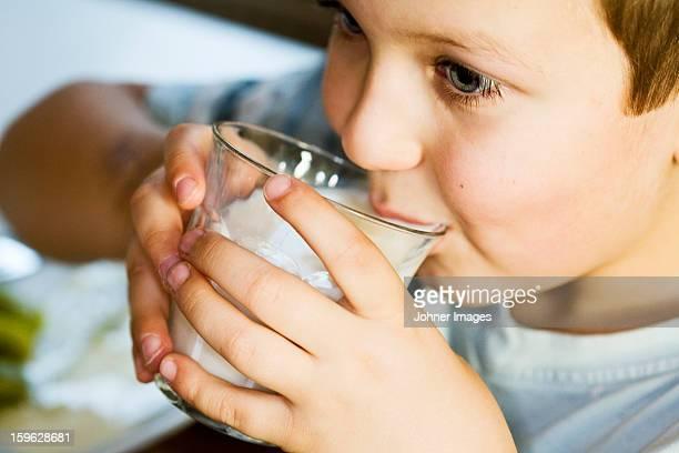 Boy drinking milk, Sweden.
