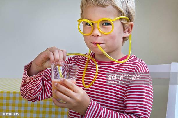 Boy drinking through curly straw