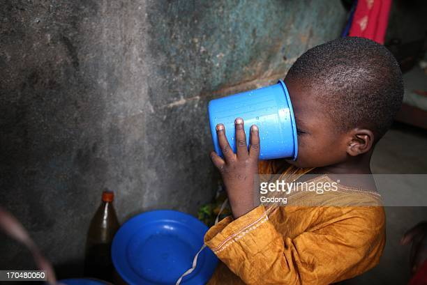 Boy drinking water Bamako Mali