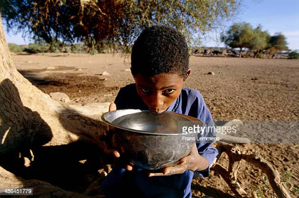 boy drinking water, niger, africa - en:public_domain stock pictures, royalty-free photos & images