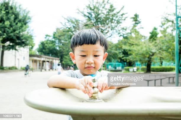 a boy drinking water - yusuke nishizawa bildbanksfoton och bilder