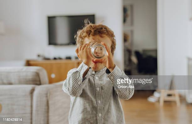 boy drinking water - drinking water stock pictures, royalty-free photos & images