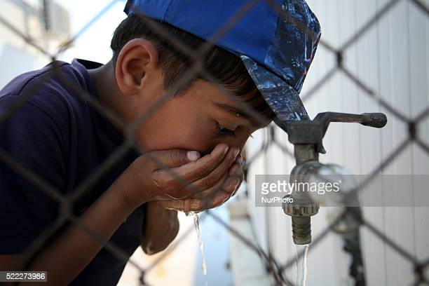 A boy drinks water from a faucet Refugee camp in Skaramaga area a port town 11 km west of Athens A large camp is being constructed here with a big...