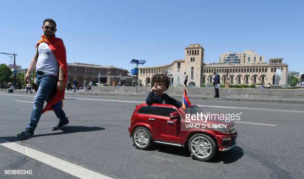 A boy drives a toy car on May 2 2018 in Yerevan as popular anger exploded over the ruling party's rejection of opposition leader's premiership bid...