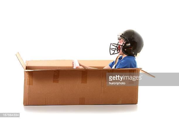 boy driving a box