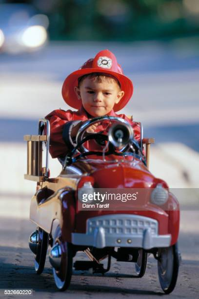 Boy Driving Toy Firetruck