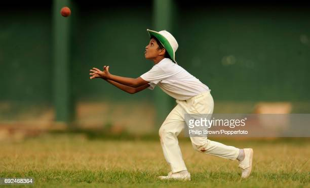 A boy during a cricket training session with a group of 7 8 year olds at Ananda College in Colombo Sri Lanka on 24th March 2011