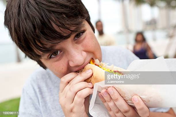 boy eating a hotdog - sausage sandwich stock pictures, royalty-free photos & images