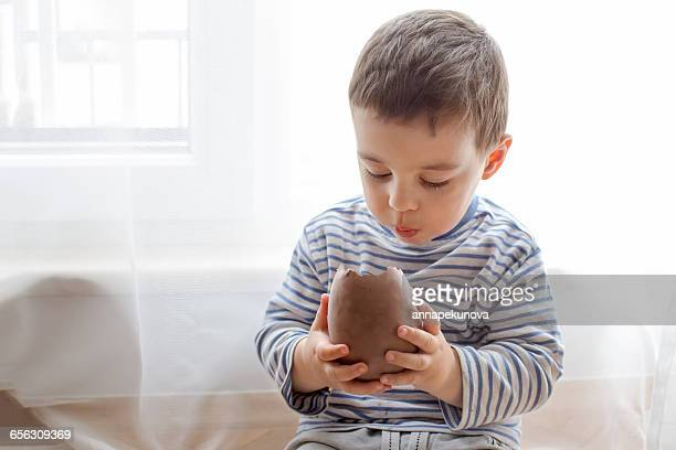 Boy eating a large chocolate easter egg