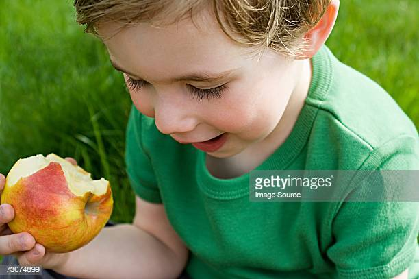boy eating apple - childhood stock pictures, royalty-free photos & images