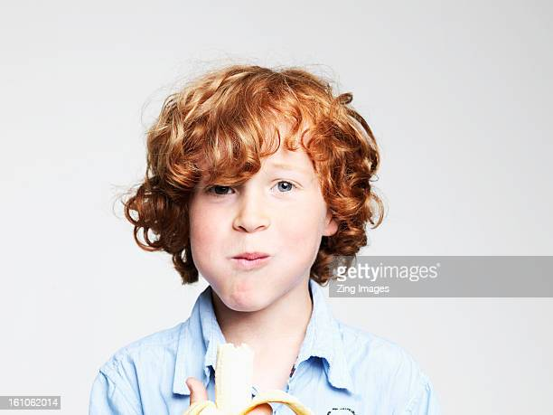 Boy eating banana