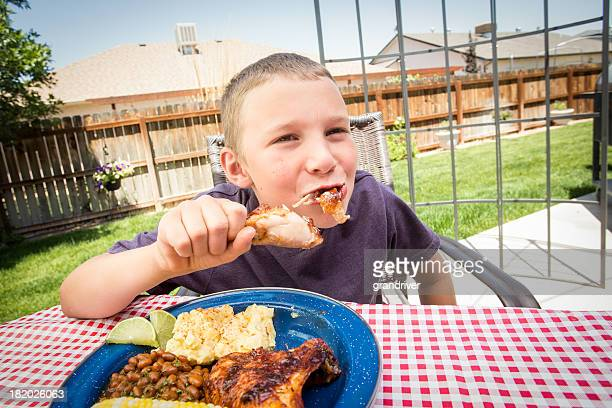 Boy Eating Barbecue Chicken