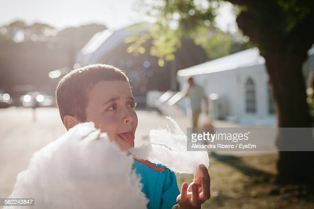 Boy Eating Candy Floss On Sunny Day