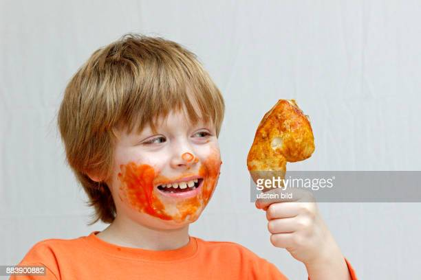 Boy Chicken Eat Stock Photos And Pictures