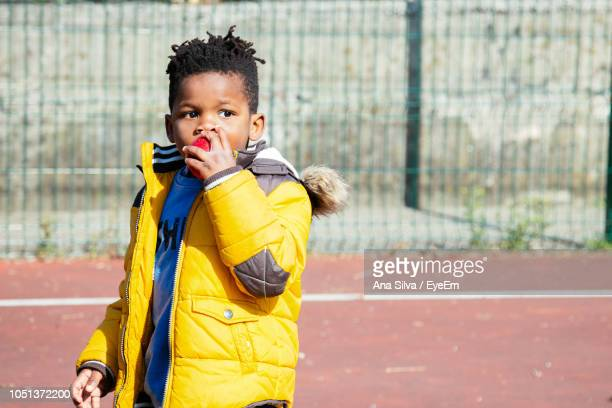 Boy Eating Food During Sunny Day