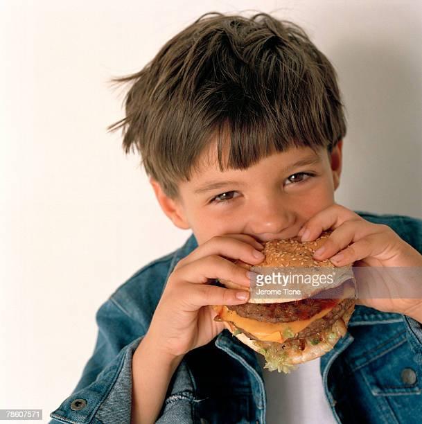Boy eating hamburger